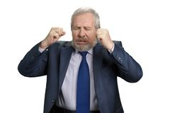 Mad crazy old man regrets awful mistake. Senior businessman made investment mistake. White isolated background Stock Photography