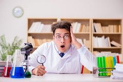 The mad crazy scientist doctor doing experiments in a laboratory Stock Images