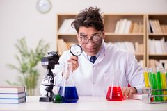 The mad crazy scientist doctor doing experiments in a laboratory Stock Photography