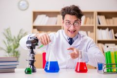 The mad crazy scientist doctor doing experiments in a laboratory