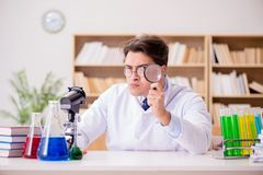 The mad crazy scientist doctor doing experiments in a laboratory Royalty Free Stock Photography