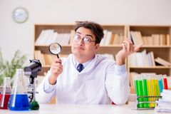 The mad crazy scientist doctor doing experiments in a laboratory Royalty Free Stock Photos