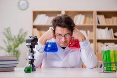 The mad crazy scientist doctor doing experiments in a laboratory Stock Image