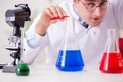 The mad crazy scientist doctor doing experiments in a laboratory Royalty Free Stock Image