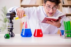The mad crazy scientist doctor doing experiments in a laboratory Stock Photo