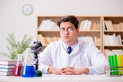 The mad crazy scientist doctor doing experiments in a laboratory Royalty Free Stock Photo