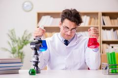 The mad crazy scientist doctor doing experiments in a laboratory Stock Photos