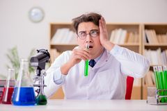 The mad crazy scientist doctor doing experiments in a laboratory. Mad crazy scientist doctor doing experiments in a laboratory Royalty Free Stock Photography