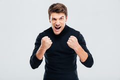 Mad crazy young man threatening with fists and shouting Royalty Free Stock Photos