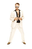 Mad disco dancer in white suit and snake leather boots. On white background Stock Photography