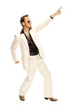 Mad disco dancer in white suit and snake leather boots. On white background Royalty Free Stock Photo