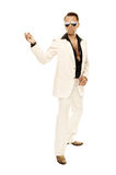 Mad disco dancer in white suit and snake leather boots Royalty Free Stock Photography