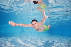 Mad diving in pool. Underwater shoot Royalty Free Stock Photo