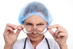 Mad doctor in a hat and glasses Royalty Free Stock Photos