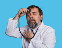 Mad doctor with a stethoscope Royalty Free Stock Photography