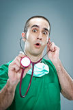 Mad Doctor with a Stethoscope Royalty Free Stock Photo
