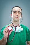 Mad Doctor with a Stethoscope Royalty Free Stock Image