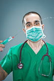 Mad Doctor with a Syringe Stock Photo