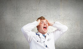 Mad doctor Stock Images