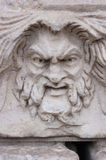 Mad face sculpture Stock Images