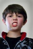 Mad Face Young Boy Stock Photos