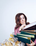Mad faced teacher with folders in hands stock images