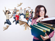 Mad faced teacher with folders in hands and her jump pupils Royalty Free Stock Images