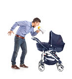 Mad father yelling to his baby Royalty Free Stock Photo