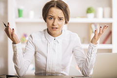Mad female at workplace Stock Photography
