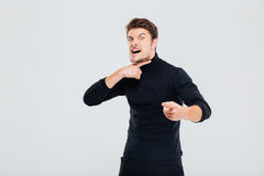 Mad furious young man threatening and pointing on you. Isolated Royalty Free Stock Image