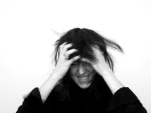Mad GIRL. Shaking head crazy,girlish stock photo
