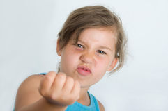 Mad girl with raised fist Stock Photo