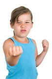 Mad girl with raised fist Stock Photography