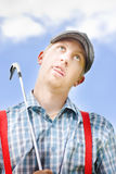 Mad About Golf. Sees Crazy Golfer Pull Silly Expression Behind Cloud Blue Sky While Clutching His Iron Golf Club In Ridiculous Half Body Portrait Stock Photography