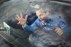 Mad at GPS. Drivers GPS navigation broke and show him a wrong way. Driver is lost and mad Stock Image
