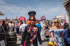 Mad Hatter and Alice characters at purim celebration party. TEL-AVIV, ISRAEL - MARCH 24, 2016: Mad Hatter and Alice characters at purim celebration party in Tel royalty free stock photography