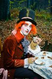 Mad Hatter with a cup of tea in his hand. Image of Mad Hatter from a themed shoot of Alice in Wonderland royalty free stock photography