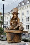 Mad Hatter. LLANDUDNO October 30th 2014. A carved wooden statue of Lewis Carrol's Mad Hatter from the Alice in Wonderland story. The sculpture by Simon Hedger Royalty Free Stock Image