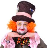Mad hatter`s different facial emotions. Close-up portrait of smi. Ling and fooling around animator in various theater roles. Emotional and colorful Stock Photo