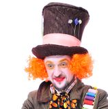 Mad hatter`s different facial emotions. Close-up portrait of smi. Ling and fooling around animator in various theater roles. Emotional and colorful Stock Photography