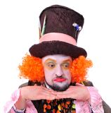 Mad hatter`s different facial emotions. Close-up portrait of smi. Ling and fooling around animator in various theater roles. Emotional and colorful Stock Photos