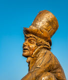 Mad Hatter Sculpture. LLANDUDNO April 9th 2015. A carved wooden statue of Lewis Carrol's Mad Hatter from  Alice in Wonderland. Sculpted by Simon Hedger who marks Stock Photos