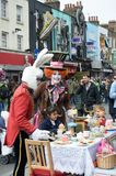 Mad Hatters Tea Party on street with men in costume Stock Photos