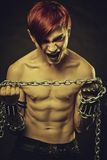 Mad head. Crying redhead aggresive gothic man with chains Stock Images