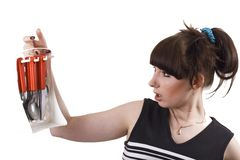 The mad housewife with knifes, spoons, plugs Royalty Free Stock Photos
