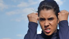 Mad Latina Person. A young female hispanic teen stock photography