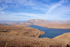 Mad-Made Reservoir Surrounded by Dry Winter Grassland Royalty Free Stock Photos