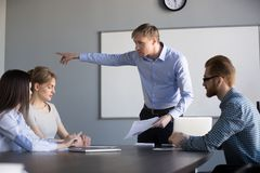 Mad male ceo ask female worker leave company meeting. Mad businessman ask female worker leave company briefing because of bad work results or incompetent royalty free stock images