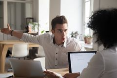 Mad male employee blaming female colleague for mistake royalty free stock image