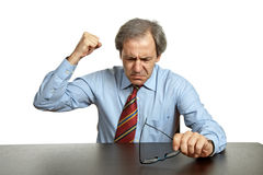 Mad man. Worried business man on a desk, isolated on white Stock Photo